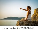 beautiful young woman enjoying... | Shutterstock . vector #710868745