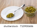 Spoon With Green Peas In Plate...