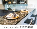 grapes on plate of modern... | Shutterstock . vector #710933902