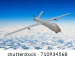 Unmanned military aircraft background blue sky clouds - stock photo