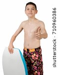 Young teenage caucasian boy with his body board - stock photo