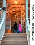 children in halloween costumes  ... | Shutterstock . vector #710963002