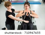 young fit woman exercising on... | Shutterstock . vector #710967655