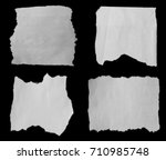 pieces of torn paper on black | Shutterstock . vector #710985748