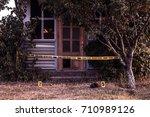crime scene tape near the house ...   Shutterstock . vector #710989126