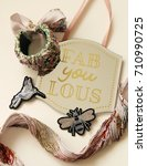 Small photo of You are FABULOUS sign with bridal bracelet, silk fabric scarp and clothes appliques in bird and insect shape.