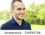man  young  attractive  smiling ... | Shutterstock . vector #710992738