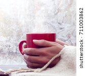 hot red mug in the hands... | Shutterstock . vector #711003862