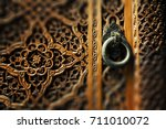 ancient wooden door and metal... | Shutterstock . vector #711010072