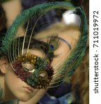 Small photo of EDINBURGH - August 11, 2005: An unknown performer wears a mask made of peacock feathers to publicise her show at the Edinburgh fringe on August 11, 2005.