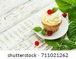 delicate vanilla cupcakes with... | Shutterstock . vector #711021262