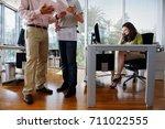 people working in modern office   Shutterstock . vector #711022555