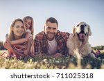 beautiful happy family is... | Shutterstock . vector #711025318