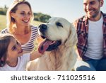 beautiful happy family is... | Shutterstock . vector #711025516