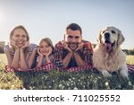 beautiful happy family is... | Shutterstock . vector #711025552