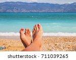 sea beach feet holidays | Shutterstock . vector #711039265