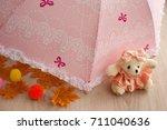 children's pink umbrella. a... | Shutterstock . vector #711040636