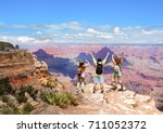 people with hands up jumping ... | Shutterstock . vector #711052372
