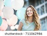portrait of happy beautiful... | Shutterstock . vector #711062986