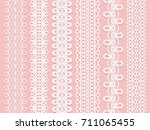 wide lace ribbons set on a pink ...   Shutterstock . vector #711065455