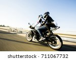 man and woman wearing leather... | Shutterstock . vector #711067732