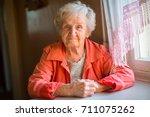 portrait of stern elderly women. | Shutterstock . vector #711075262