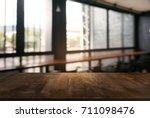 empty wooden table in front of... | Shutterstock . vector #711098476