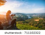 a young woman photographs the... | Shutterstock . vector #711102322