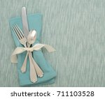 teal table place setting with...   Shutterstock . vector #711103528