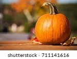 Pumpkin And Autumn Leaves On...