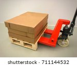 pallet on manual pallet truck. | Shutterstock . vector #711144532