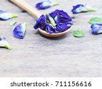 wooden spoon with blue... | Shutterstock . vector #711156616