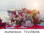 Two Wine Glasses And Flowers...