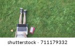 top view photo of girl in grass ...   Shutterstock . vector #711179332