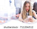 pensive blonde teenager outdoor ... | Shutterstock . vector #711206512