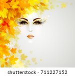 beautiful woman in autumn... | Shutterstock .eps vector #711227152