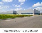 a modern factory building  | Shutterstock . vector #711255082