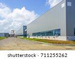 a modern factory building  | Shutterstock . vector #711255262