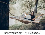 stylish hipster freelancer with ... | Shutterstock . vector #711255562
