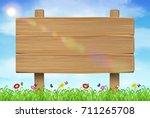 wooden board sign on grass sky... | Shutterstock .eps vector #711265708