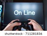 hands holding a joystick... | Shutterstock . vector #711281836