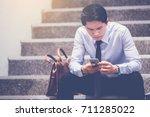 stressed businessman use smart... | Shutterstock . vector #711285022
