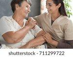 young nurse in beige uniform...   Shutterstock . vector #711299722