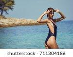 pretty beautiful woman in white ...   Shutterstock . vector #711304186
