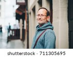 outdoor portrait of 50 year old ... | Shutterstock . vector #711305695