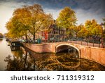 beautiful canals in amsterdam... | Shutterstock . vector #711319312
