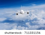 aeroplane flying above clouds.... | Shutterstock . vector #711331156