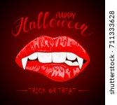 female lips with vampire fangs...   Shutterstock . vector #711333628