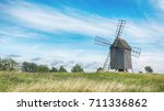 old wooden windmills on... | Shutterstock . vector #711336862
