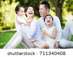 young happy asian family... | Shutterstock . vector #711340408